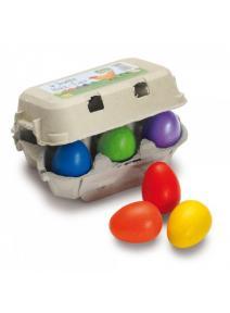 Huevos de colores de madera