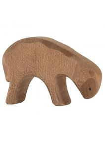 Oveja de madera marrón comiendo