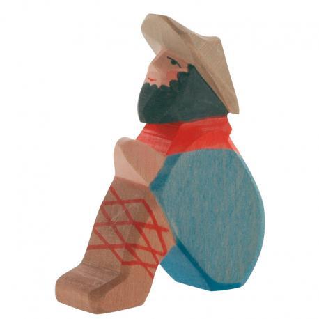 Pastor de madera sentado