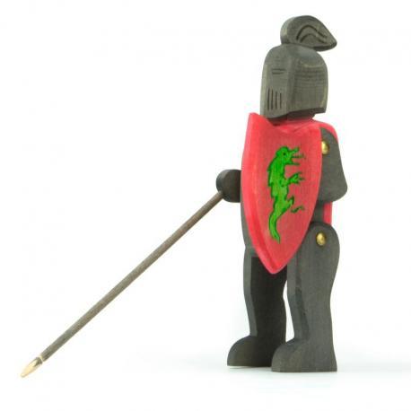 Caballero de madera montando negro